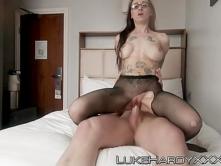 Guy and his woman check into hotel room and he fucks shaved pussy through ripped pantyhose