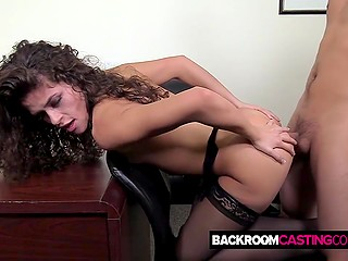 Tempting girl in sexy stockings bent over table and received agent's moistened penis into asshole