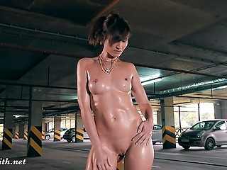 Russian minx Jeny Smith takes off clothes and oils tiny goodies at private parking
