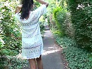 Dark-skinned British exhibitionist lifts up white summer dress and walks through the streets 6