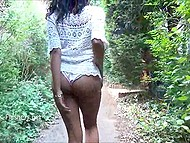 Dark-skinned British exhibitionist lifts up white summer dress and walks through the streets 7