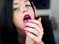 Arousing brunette with bright lipstick puts slim hand around long dick of Bulgarian man