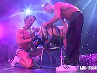Mature Norwegian pornstar lifts butt up on stage and enjoys two strippers toying her vagina 4