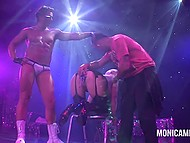 Mature Norwegian pornstar lifts butt up on stage and enjoys two strippers toying her vagina 8