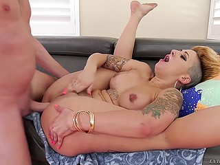 Tattooed slut with unusual hairstyle received hard dick into asshole after deepthroat blowjob
