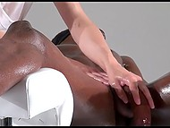 Black-skinned male blindfolds himself to concentrate on feelings during professional dick massage 9