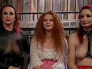 Girls with red hair focus on cunnilingus and strapon but woman in leather clothes flogs them 5
