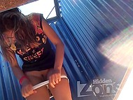 Tanned babe enters dressing cabin after sunbathing and takes off panties on hidden camera 10