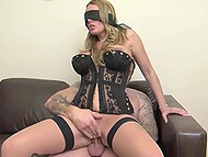 Astounding female with blindfold and in sexy lingerie enjoys sex with stranger