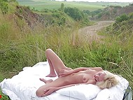 Skinny blonde in sexy white lingerie gently rubs shaved pussy in quiet outdoor spot 10