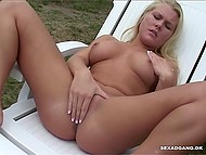 After blonde cutie takes off white panties, she lies on the sun lounger and begins to masturbate pussy 4