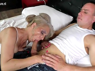 Old woman with unshaved vagina surprisingly manages to seduce young dude