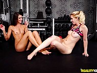 Blonde Sierra Nicole and her skinny girlfriend finger bald pussies in the middle of sport gym 8