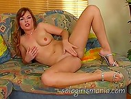 Beautiful chick is alone at home and she spends time by tenderly massaging her clit