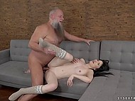 Tiny brunette girl prefers old bearded man's cock in her pussy more than young one
