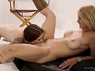 Redhead with colorful tattoo licks and fingers trimmed vagina of her blonde lover 5