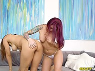 Inked pornstar with dyed hair spreads legs wider to get cunnilingus from voluptuous colleague 5
