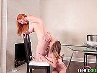 Red-haired MILF and her petite stepdaughter explore pussies in kitchen with spoons 9
