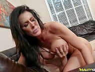 Woman with great hooters moans and licks lips in pleasure when man works on her cunt 10