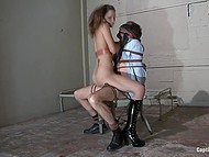 Lascivious woman Amber Rayne gives a tough lesson to man fucking him with strapon in BDSM-cellar 6