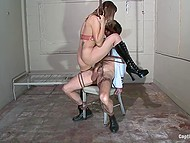 Lascivious woman Amber Rayne gives a tough lesson to man fucking him with strapon in BDSM-cellar 7