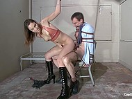 Lascivious woman Amber Rayne gives a tough lesson to man fucking him with strapon in BDSM-cellar