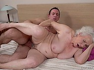 Granny with gray hair can't stop her sexual desire and ensnares another young man doing her hairy pussy