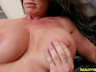 Racy MILF with huge juicy melons restlessly gets it on with younger guy on big sofa 9