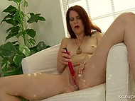 Redhead MILF with flabby boobs and butt arms with tiny vibrator and gives sexual joy to cunt