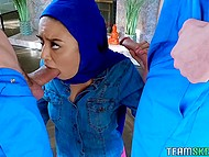 Good-looking Latina Maya Bijou in hijab is fucked by two stevedores who cum on girl's face 4