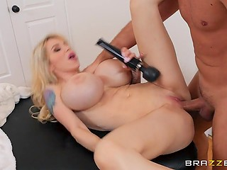 Enormous hooters of blonde pornstar are wildly bouncing in the rhythm of masseur's frictions