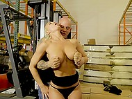 Voluptuous blonde customer puts eye on bald loader in storage because of his athletic body