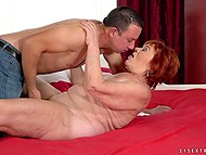 Youngster touches breasts of old woman with red hair and shamelessly sticks cock in vagina
