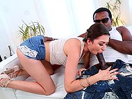 Excited pornstar Melissa Moore takes black giant out of macho's pants and puts lips around it 4