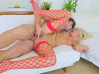 Hot blonde in red stockings and her skillful colleague enjoy awesome anal sex on sofa