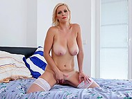 MILF with lovely features trusts no one with her pussy so she satisfies herself with fingers