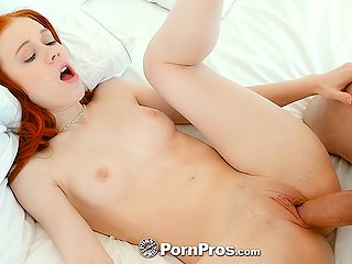 Cool chick with fire red hair trustingly gives shaved pussy to young man for fucking