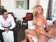 Bearded man throws a leg to big-boobied MILF with blonde hair in front of her husband 5
