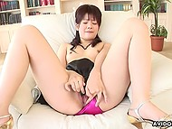 Well-groomed Japanese lady timidly slides panties aside and pushes small vibrator to hairy pussy 10