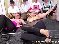 German whore and friend with red mohawk are fucked by group of raunchy Bavarian men
