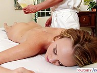 Hot blonde lies on table and experiences awesome massage given by talented rubber 7