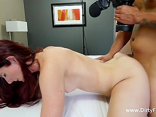 Cute chick with long red hair accepted agent's offer to suck dick and have quickie