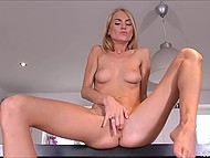Skinny blonde with perky tits actively masturbates her moist clit on kitchen counter