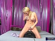 Ravishing blonde Codi Carmichael with big tits tries to receive orgasm sitting on fucking machine