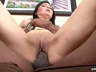 Powerful frictions by black male give a lot of pleasure to MILF with black hair and small tits 5