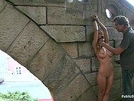 Male chains big-tittied whore to stone arch and shamelessly fucks her in public place 4