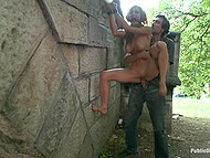 Male chains big-tittied whore to stone arch and shamelessly fucks her in public place 6