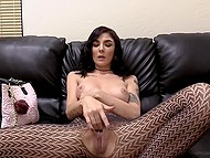 Slender brunette in sexy pantyhose toys shaved pussy specially for cameraman