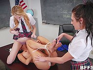 Strict teacher has unusual ways of punishing students, who are forced to lick pussies on her table