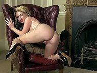 Big-tittied female often polishes wet vagina in leather armchair by the fireplace 5